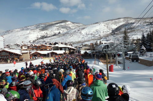 A weekend lift line at Vail. Source: Wikipedia